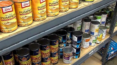 Canned food items on a shelf at Manna House