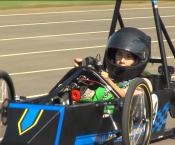 A student drives a Greenpower car in preparation for Indianapolis