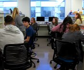 New Century Technology Students working in a technical lab