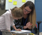 Ms. Stacy Lang working with a student in class